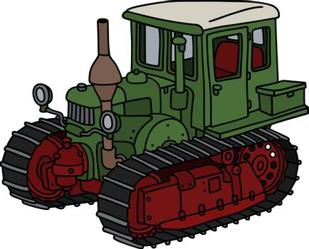 The old green caterpillar tractor