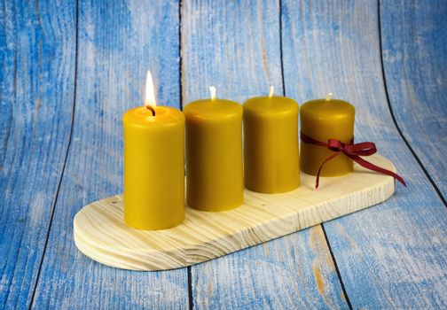 seasonal background four yellow candles on an advent candle