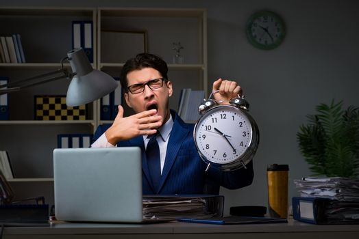Businessman falling asleep during long hours in office