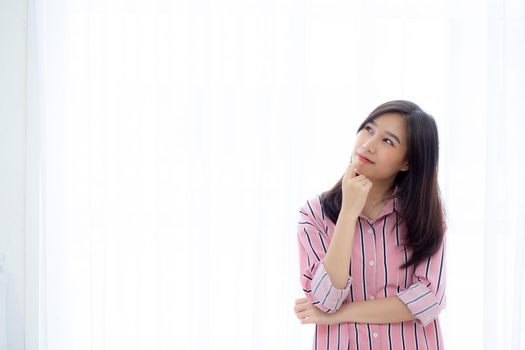 Portrait young asian woman think idea and inspiration in imagine with expressive, happy female teenage expression with presenting on curtain white background, creativity and dream, lifestyle concept.