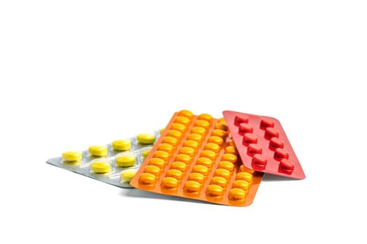 Group of medicines isolated on white. Medicinal anti-inflammatory drugs in multi-colored packaging. Pharmacy pharmacological preparations.