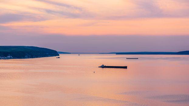 Sunset on navigable river