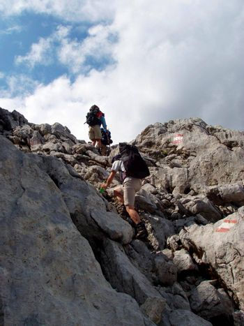 hiking in the mountains of the alps, sports and outdoor activity