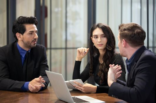 Young business team discussing and studying statistics in a meeting room