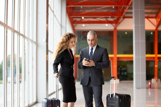 Business people on travel at Airport, Business man at international airport moving to terminal gate for airplane travel trip - Mobility concept and aerospace industry flight connections