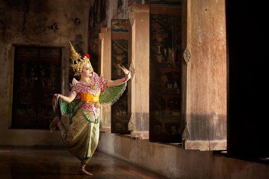 Beautiful Thai young woman portrait in Kinnaree traditional dress costume Art culture Thailand Dancing in masked khon Kinnaree in literature amayana, thailand culture Khon, Ayuttaya, Thailand .
