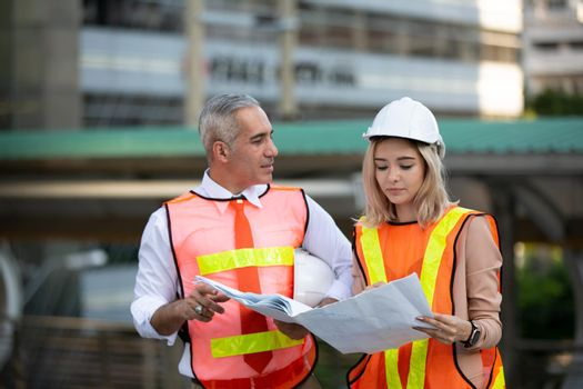 Engineering civil, Construction engineers discussion with architects at construction site or building site of high-rise building with Surveying for making contour plans