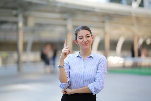 Portrait of cheerful business women standing outdoor.