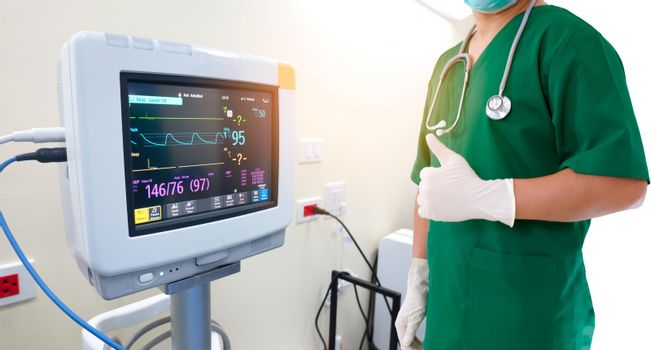 Healthcare and medical concept. Medicine doctor with stethoscope and gloves in hand and EKG Monitor   with pulse electrocardiogram in  hospital.