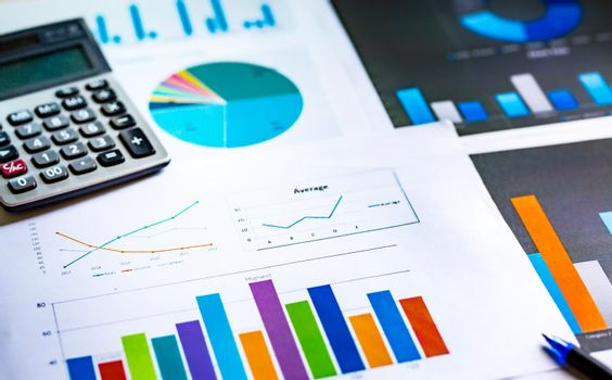 Financial analysis sheet data with pen and calculator. Accounting financial and marketing concept.