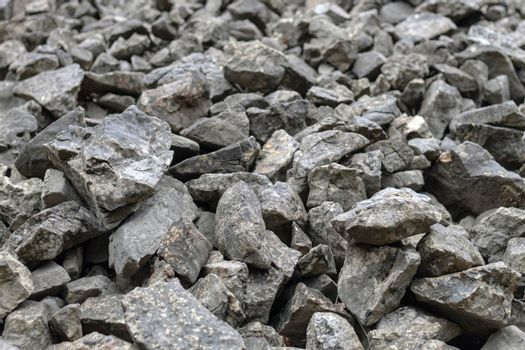 Stones scattered on the floor, building materials, texture