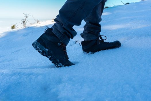 It depicts the steps of a man while walking on the snow in Winter