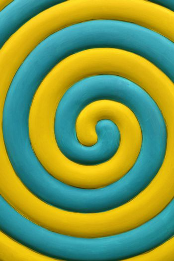 Yellow and teal blue spiral background
