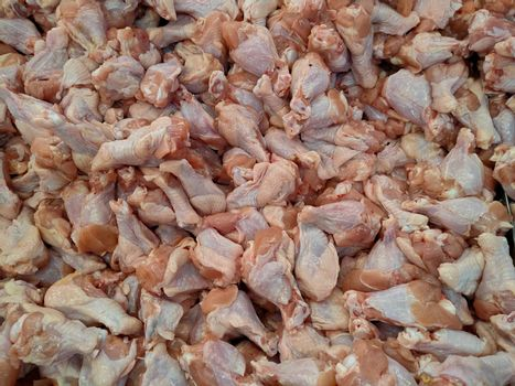 Fresh chicken drumsticks in the market, Raw material food.