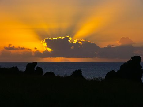 Sunset on Easter Island. The colors of sunset in the ocean.