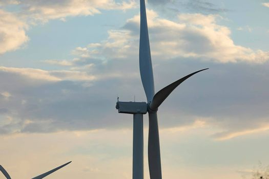 New wind turbine, recently installed in north of Spain, rotates with the wind at sunset, community of Aragon.