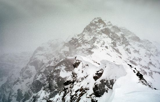 Mount Sayan in winter in the snow. The nature of the mountains is sayan.