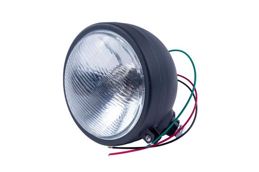 High-beam headlight in a metal case on a white background