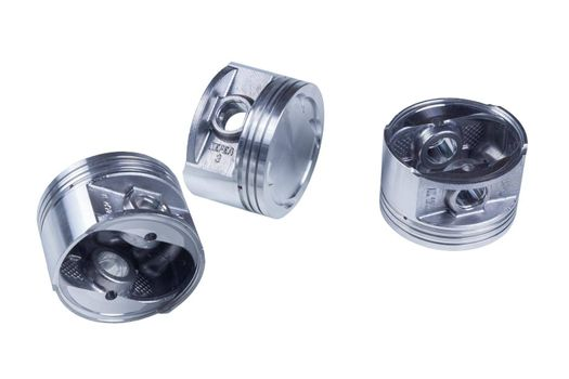 three new pistons isolated on a white background. spare parts