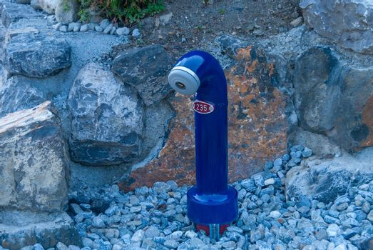 Fire hydrant on the street. Grindelwald Switzerland.