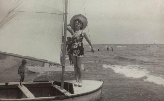 Girl at seaside in 50s