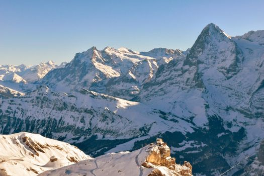 Beautiful winter mountain landscape in Sunny weather with views of Eiger. Grindelwald, Bernese Oberland Switzerland.