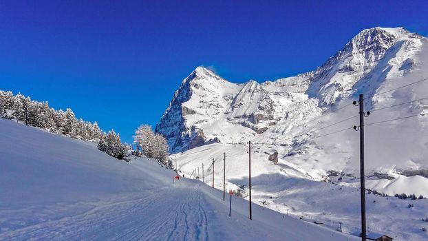 Winter landscape with views of Eiger peak and monch peak. Grindelwald Switzerland