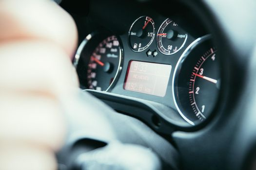 Sports car dashboard with tachometer and fuel indicator
