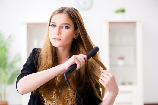 Woman styling her hair with hairdryer