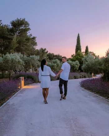 couple walking path with lavender during sunset in the Provence France Europe