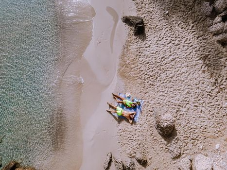 Tropical beach of Voulisma beach, Istron, Crete, Greece ,Most beautiful beaches of Crete island -Istron bay near Agios Nikolaos drone aerial view from above at the beach with people in swimsuit