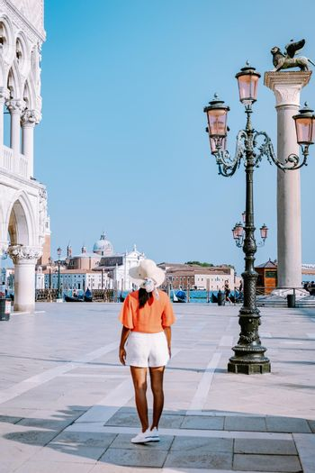 woman on a city trip to Venice Italy, colorful streets with canals Venice. Europe