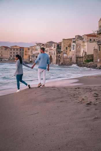 Cefalu, the medieval village of Sicily island, Province of Palermo, Italy. Europe, a couple on vacation at the Italian Island Sicilia