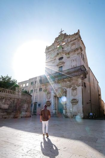 men on citytrip Ortigia in Syracuse in the Morning. Travel Photography from Syracuse, Italy on the island of Sicily. Cathedral Plaza and market with people whear face protection during the 2020 pandemic