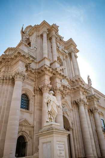Ortigia in Syracuse in the Morning. Travel Photography from Syracuse, Italy on the island of Sicily. Cathedral Plaza and market with people whear face protection during the 2020 pandemic