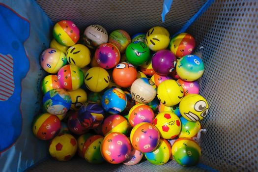 It depicts some colorful play balls for children to play them in pool and play room