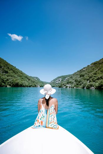 young girl view to the cliffy rocks of Verdon Gorge at lake of Sainte Croix, Provence, France, near Moustiers SainteMarie, department Alpes de Haute Provence, region Provence Alpes Cote Azur. France
