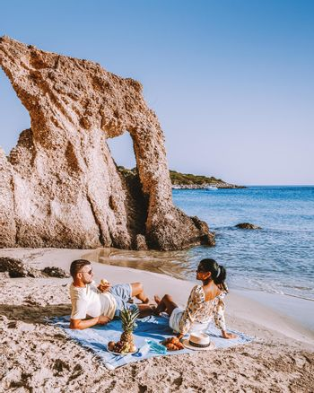 couple men and woman mid age on vacation at the Greek Island Crete. Europe
