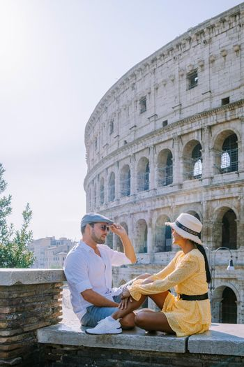 View of Colosseum in Rome and morning sun, Italy, Europe. Couple on city trip in Rome