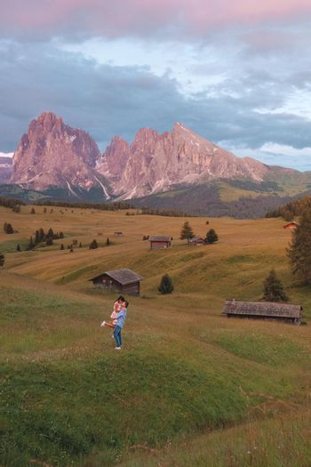 couple mid-age men and woman visiting the Italian Dolomites in Italy. Europe Alpe di Susi, Seiser alm