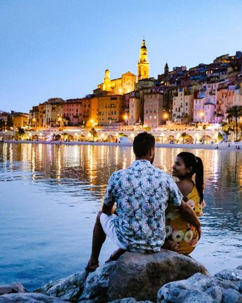 couple men and woman on vacation at the town of Menton in the Provence France during summer in Europe