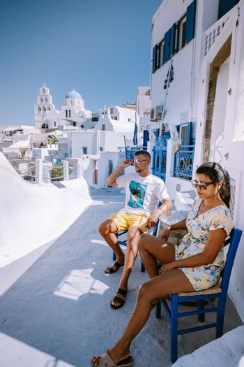 Pyrgos, Santorini, Greece. Famous attraction of white village with cobbled streets, Greek Cyclades Islands, Aegean Sea couple on vacation Santorini Greece Europe