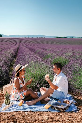 couple mid age men and woman on vacation in the Provence visiting the blooming lavender fields in France. Europe