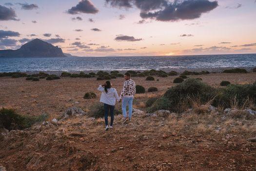 San Vito Lo Capo Sicilia, couple men and woman mid-age visiting the beach of San Vito Lo Capo Sicily Italy