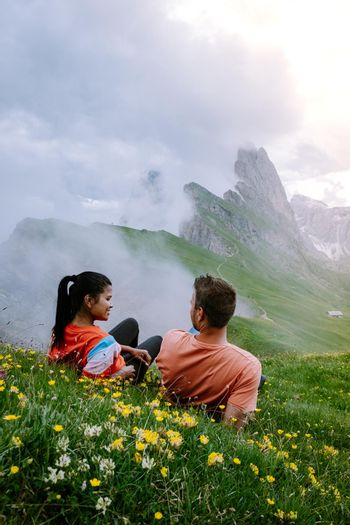 couple on vacation hiking in the Italien Dolomites, Amazing view on Seceda peak. Trentino Alto Adige, Dolomites Alps, South Tyrol, Italy, Europe.