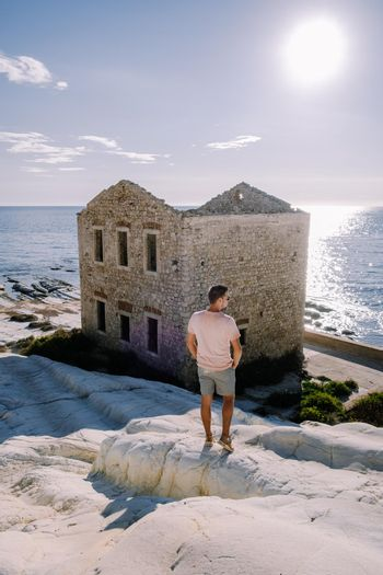 Punta Bianca, Agrigento in Sicily Italy White beach with old ruins of an abandoned stone house on white cliffs. Sicilia Italy you men on the white cliffs