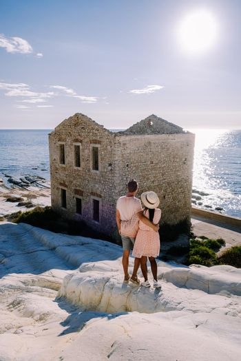 Punta Bianca, Agrigento in Sicily Italy White beach with old ruins of an abandoned stone house on white cliffs. Sicilia Italy, couple on vacation in Italy