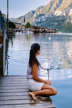 woman visit during summer vacation Hallstatt village on Hallstatter lake in Austrian Alps Austria Europe