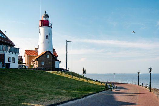 Urk Netherlands harbor and lighthouse near the beach on a bright summer day Flevoland Urk Netherlands Europe