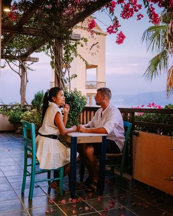 Crete Greece, Candia park village a luxury holiday village in Crete Greece by the ocean in traditional colors. Couple on vacation luxury resort